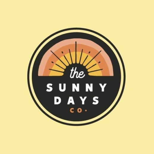 yellow, orange and peach business logo showing a sunrise with negative space sunbeams