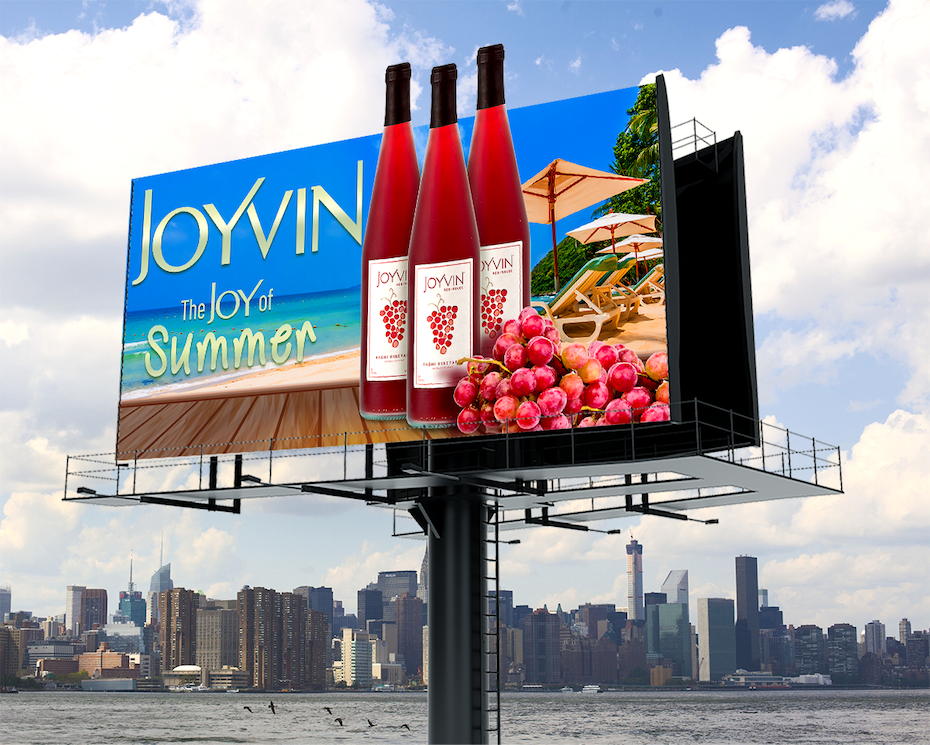 billboard ad showing wine bottles against a beachy background