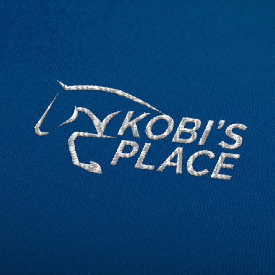 blue background with embroidered white logo of an abstract horse