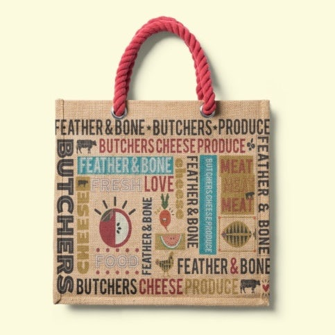 canvas bag showing a printed grocery design with images and words