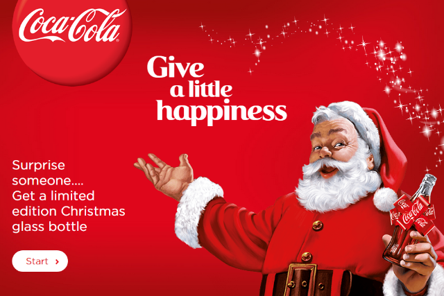 Coca-Cola ad showing Santa Claus holding a coke bottle and text