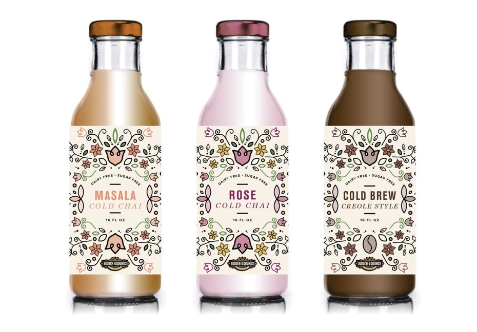 symmetry packaging design trend: cold brew bottles with intricate black, pink, green and yellow pattern on their labels