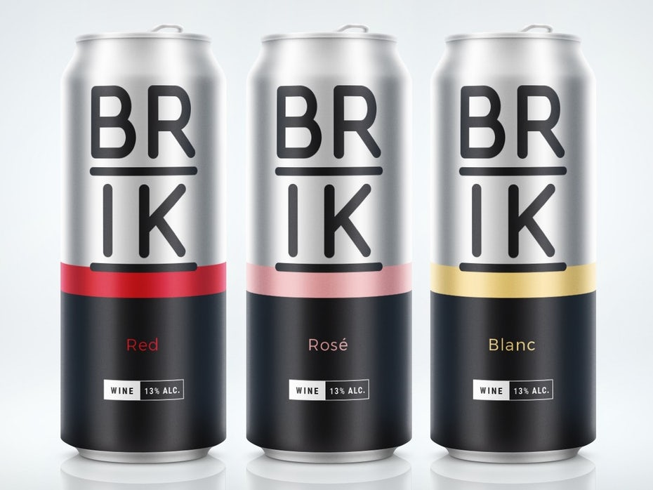 Tres latas de vino una al lado de la otra, cada una de una variedad diferente.