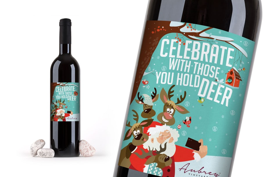 wine label showing Santa and reindeer against a tree