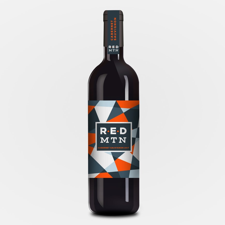 wine bottle with a sharp geometric gray and red label design