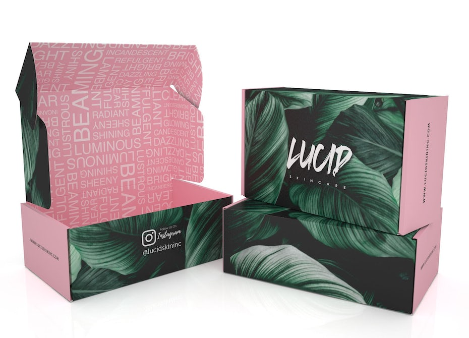 Pink skin care product packaging with green leaves