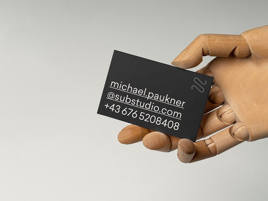 gray business card with basic white text across it