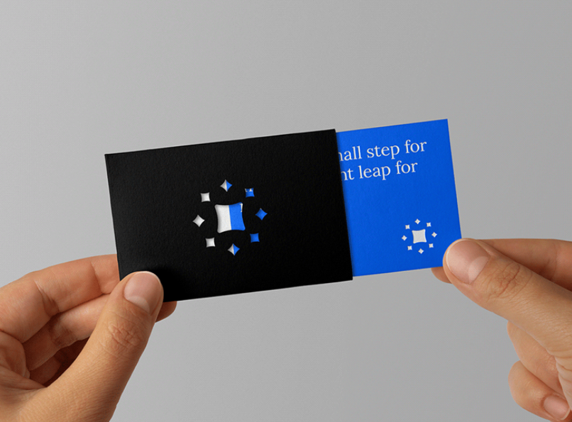 blue business card that fits into a black envelope