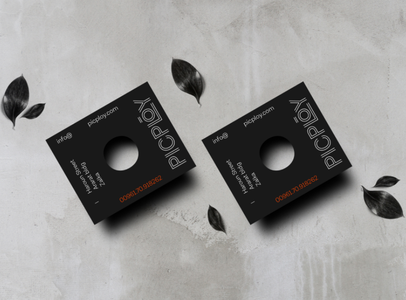 black business card with a hole in the center