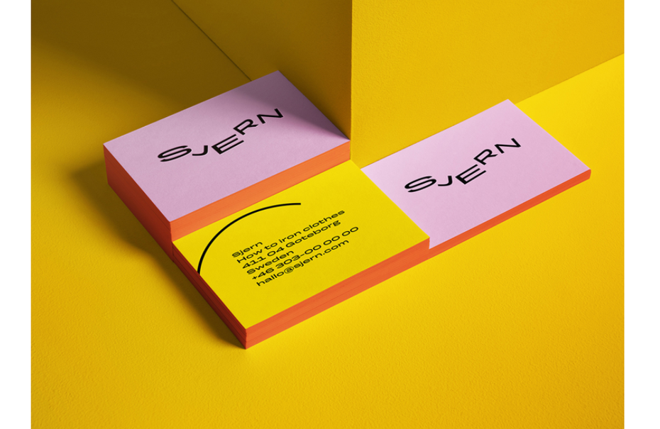 pink and yellow business cards with swoopy text