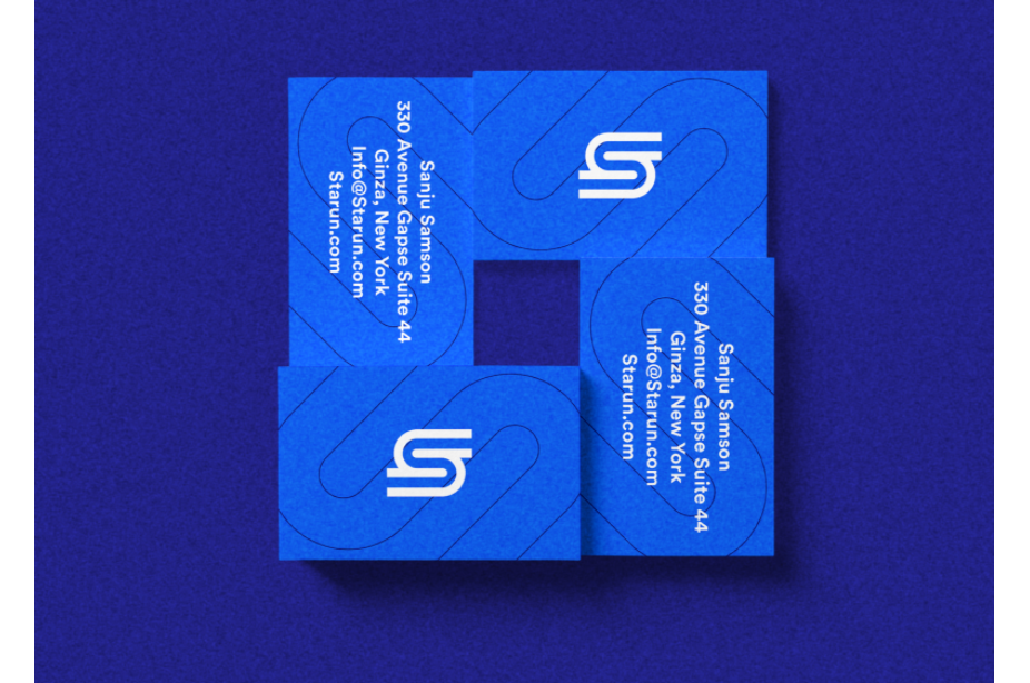 blue business cards with abstract S logo in white