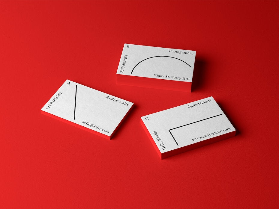 White business cards with minimalistic text and geometric lines