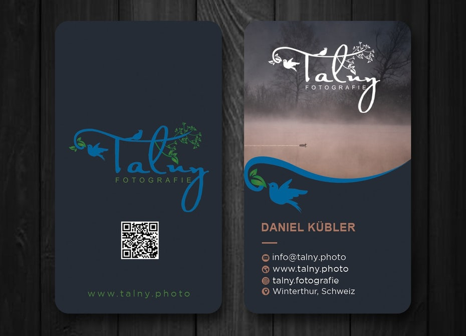 dark blue business card with a photo of a fog-covered lake