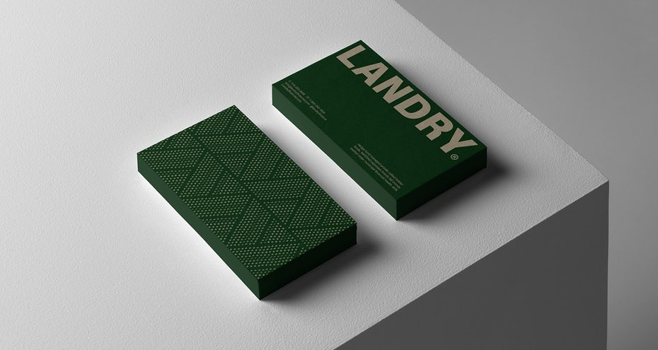 green business card with bold off-white text