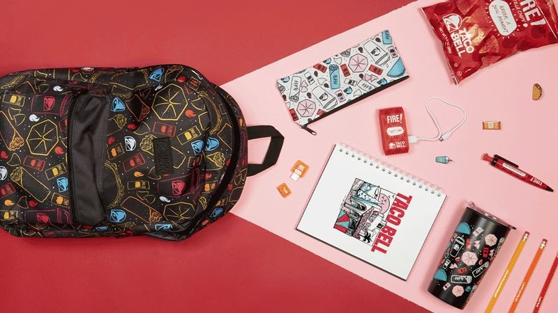 Taco Bell-branded back to school supplies including a backpack, water bottle and charger