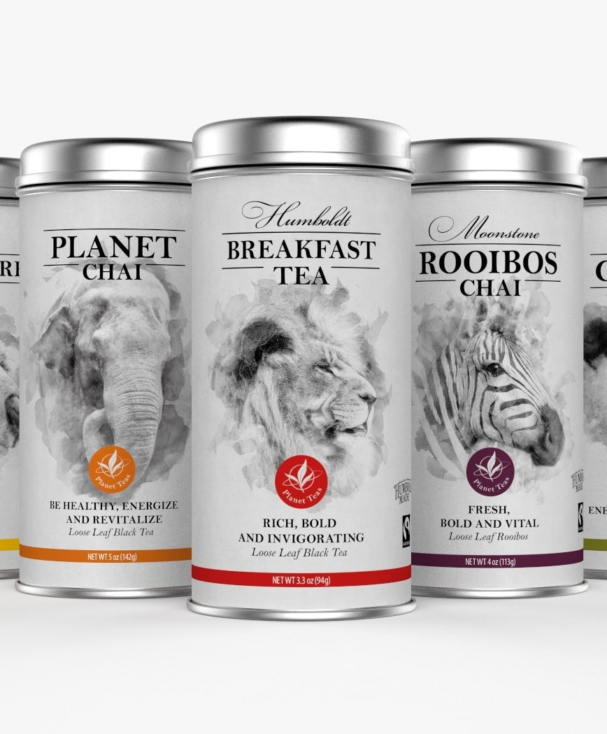collection of white tea tins, each with a black and white photo of a different animal