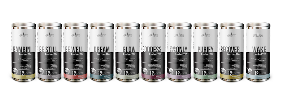 collection of tea canisters with black and white labels and sans serif text