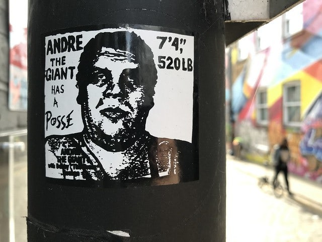 Andre the Giant sticker on a black pole