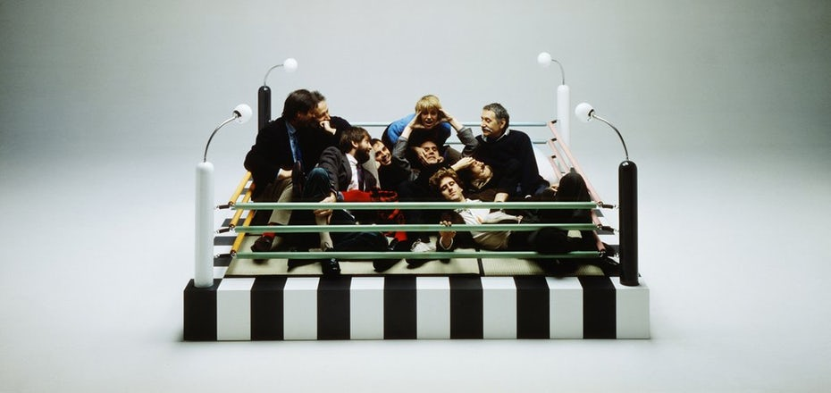 Photo of the Memphis Group sitting in a Memphis style boxing ring
