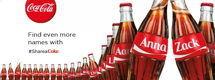 Share a Coke ad with Anna and Zach Coke bottles