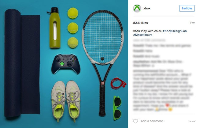 knolling image of an xbox controlled alongside athletic equipment