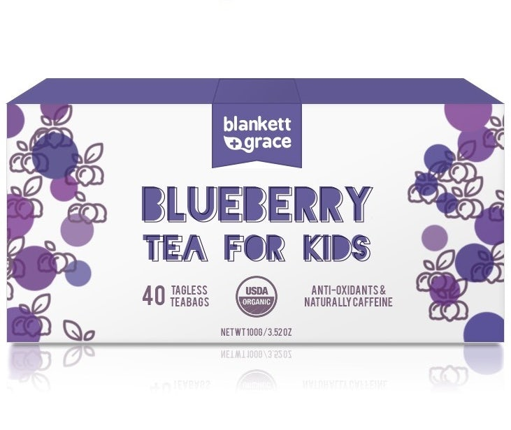 white tea box with purple text and illustrations of blueberries