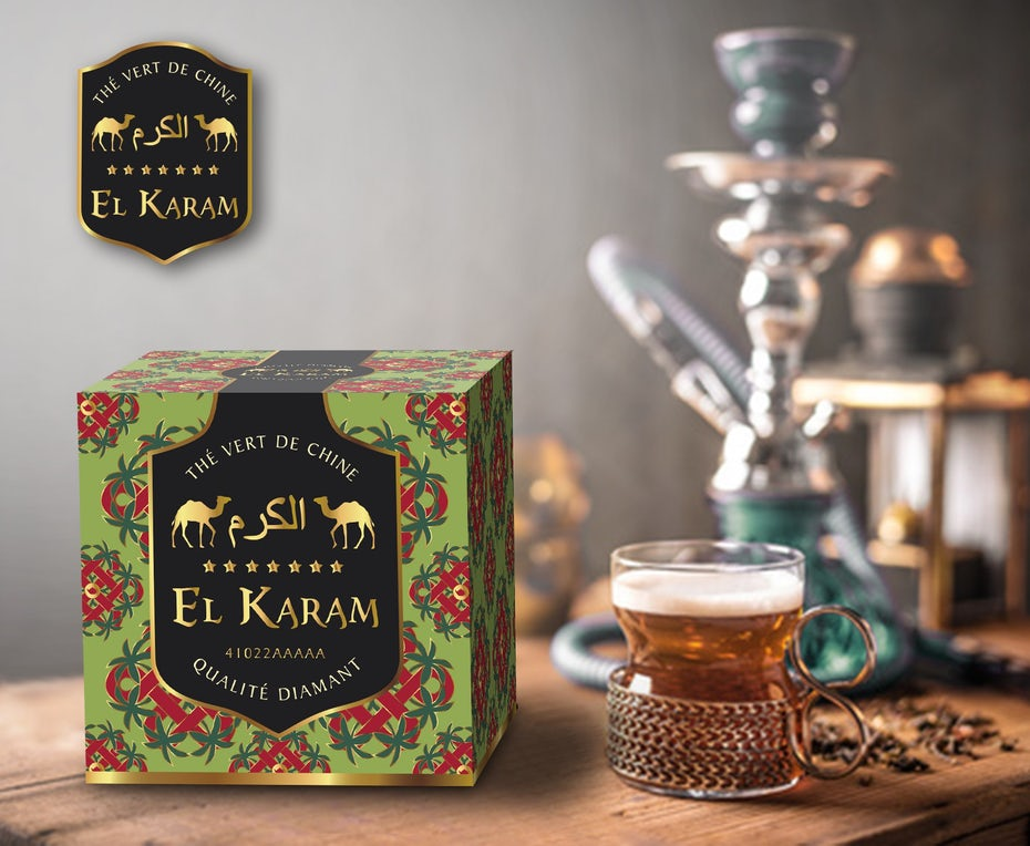 bold patterned tea box beside a hot cup of tea and a hookah
