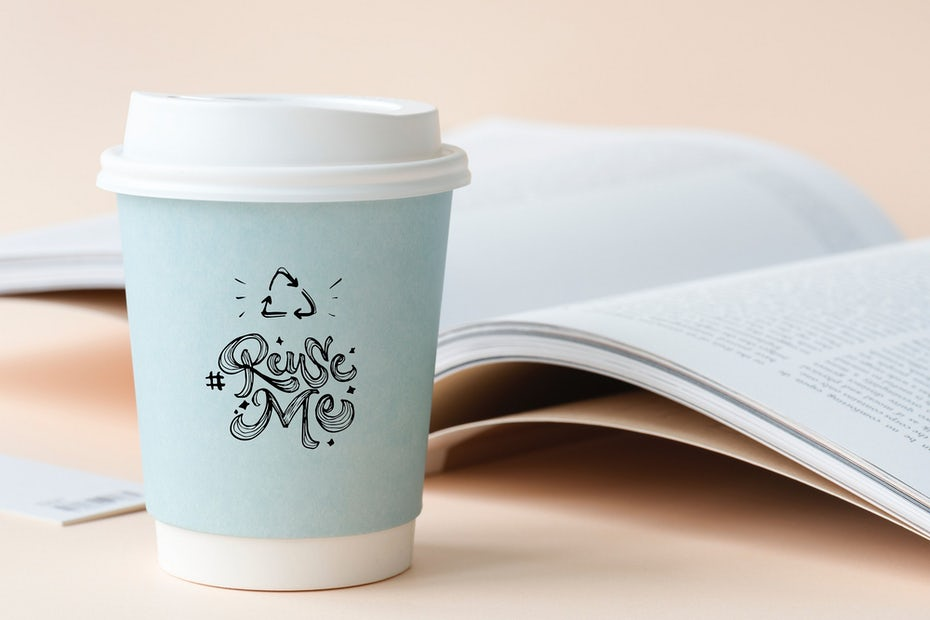 white paper cup with blue holder