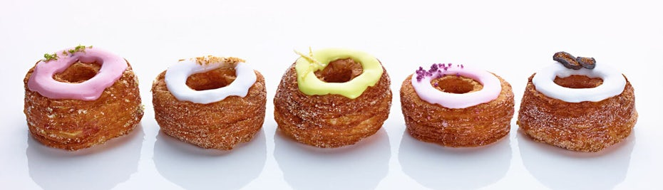 product photography of five cronuts lined up in a row