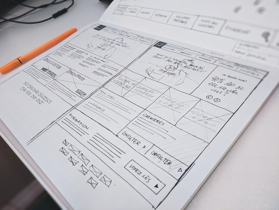 website wireframe sketch on notebook