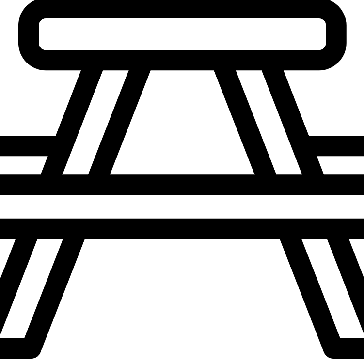 Black and white image showing a picnic table icon