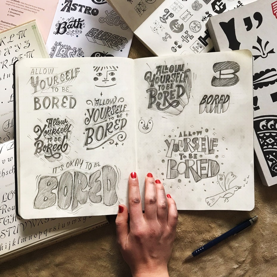 sketchbook page with logo sketching examples