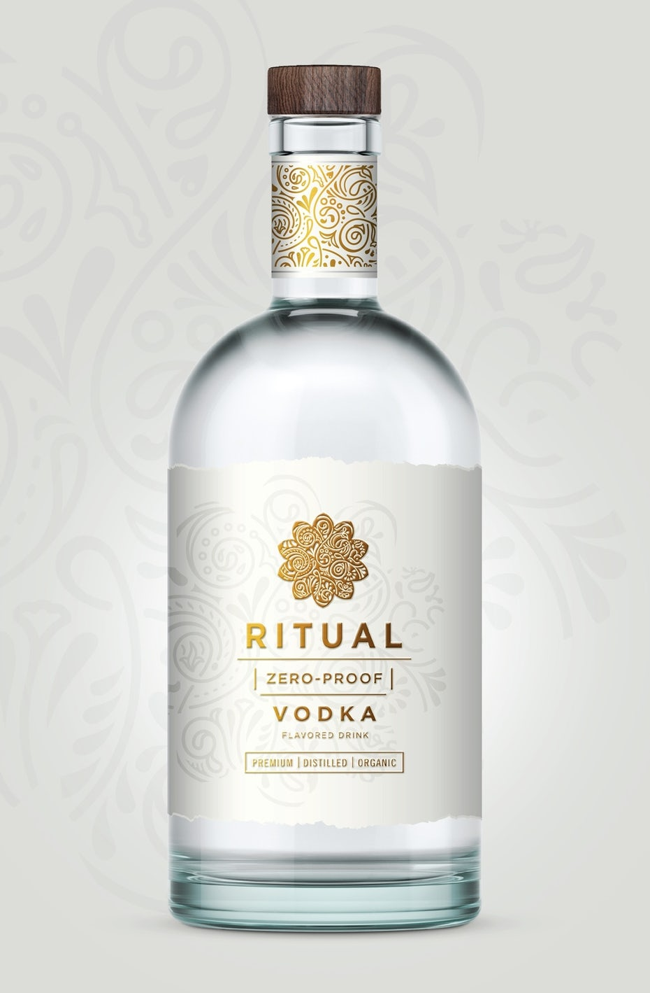 Clear bottle with a white label displaying a geometric gold logo