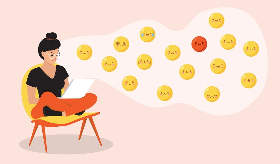 Illustration of a person sitting at a chair designing custom emojis