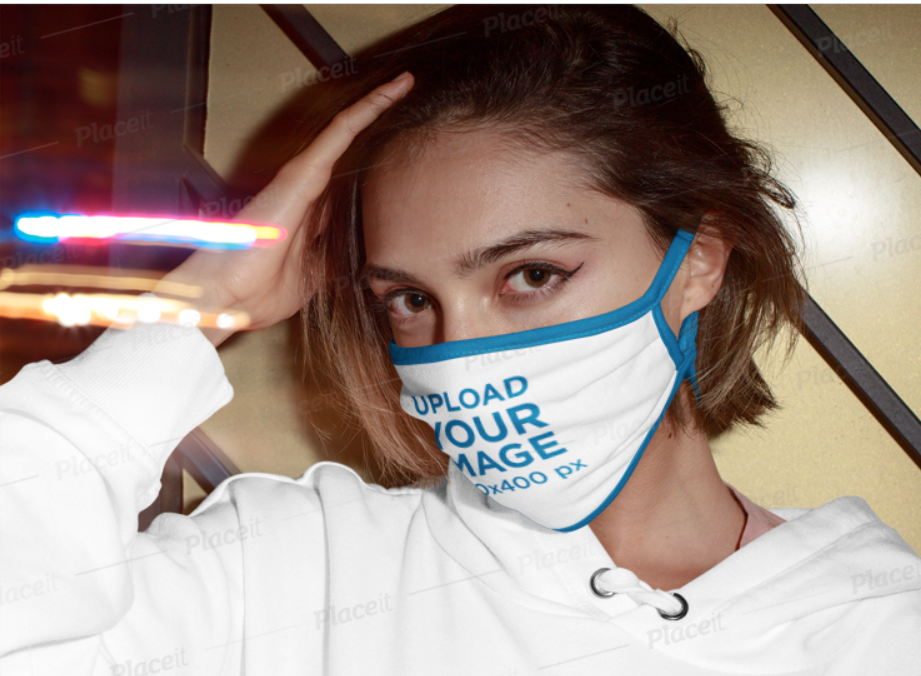 woman in a white hoodie wearing a white and blue face mask
