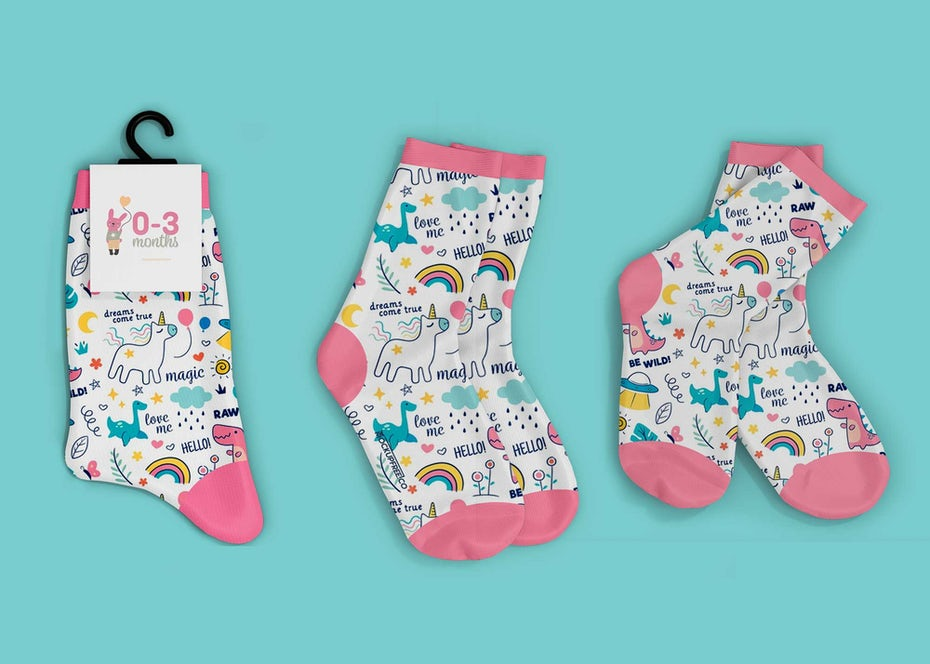 three pairs of baby socks with unicorns on them