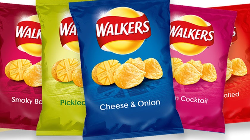 multiple flavors of Walkers crisps next to each other