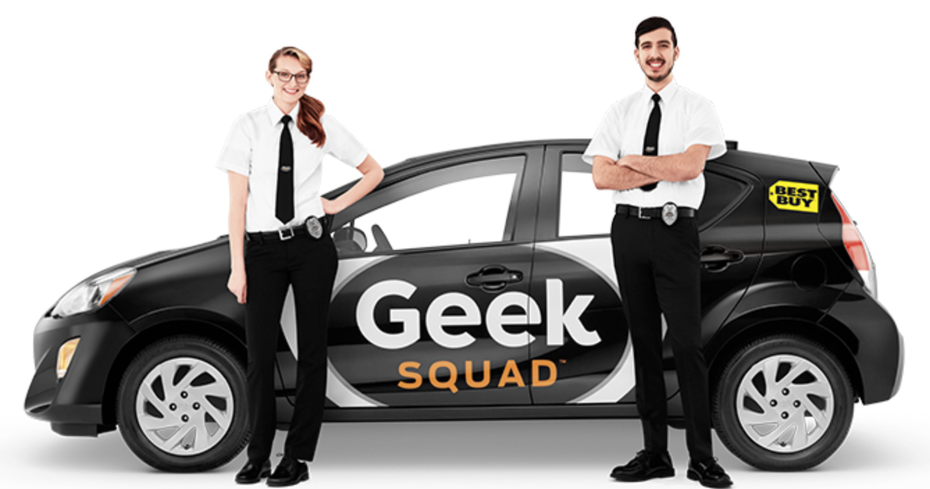 man and woman standing beside a car