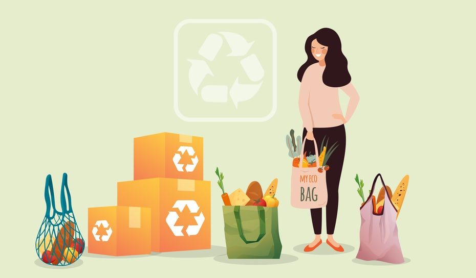 Woman surrounded by groceries and boxes, all bearing the recyclable logo!