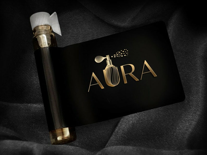 Perfume logo design with gold lettering