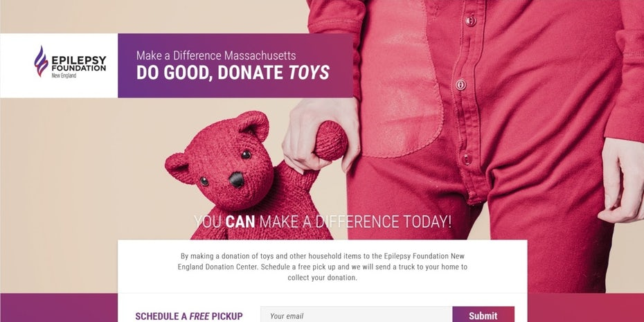 hero image showing a child's hand holding a pink teddy bear