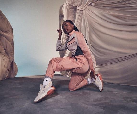 woman wearing Nikes