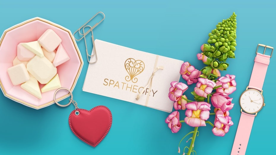 spa business card with flowers, sweets and a coordinated watch