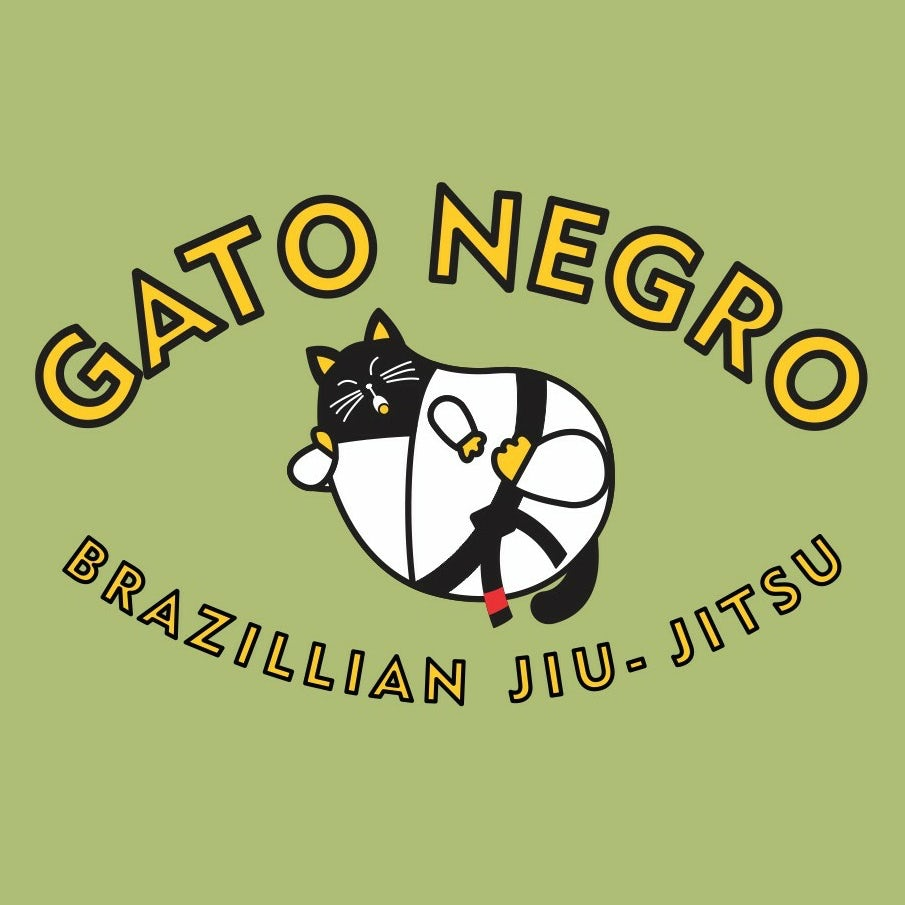 logo showing a fat, yawning black cat in a karate uniform