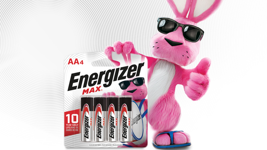 a large pink rabbit wearing a pair of shades and blue flip flops gives a thumbs up as it holds a pack of Energizer batteries