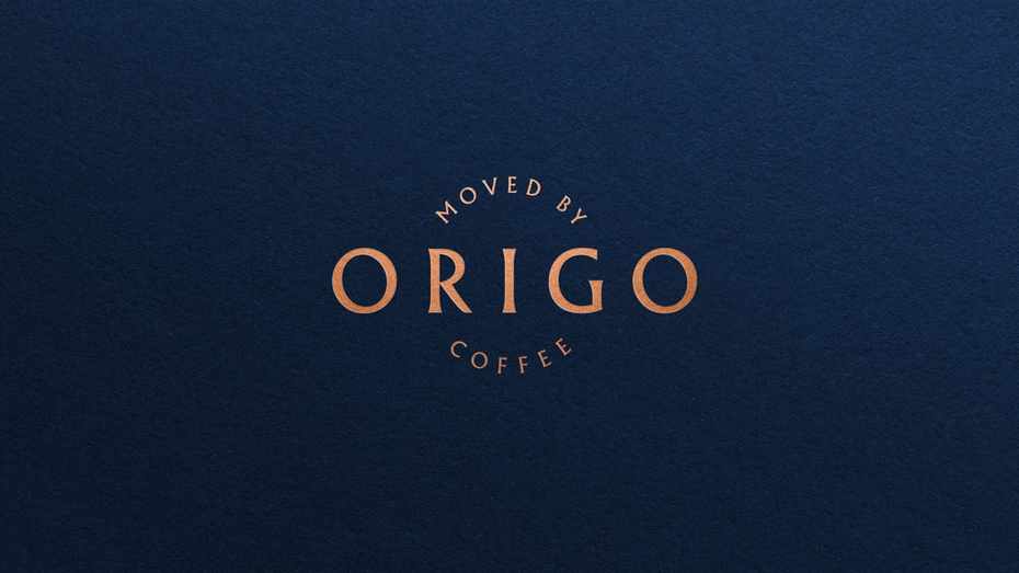 the new Origo logo in amber gold with a blue background