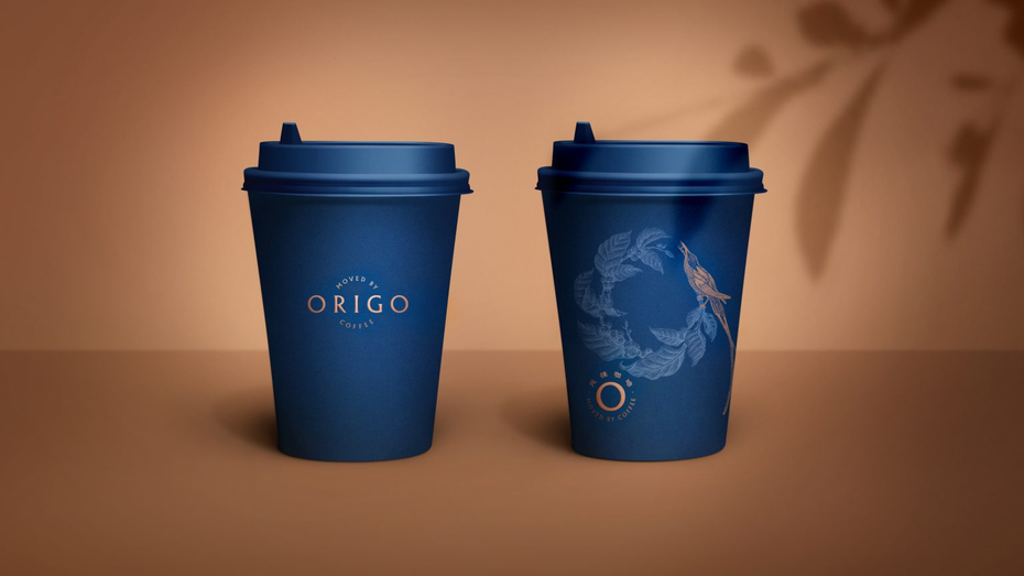 two blue coffee cups with a bird on a branch illustration