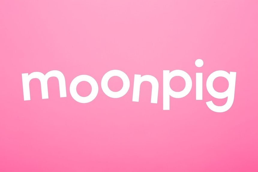 floating text of moonpig in white color against a pink background