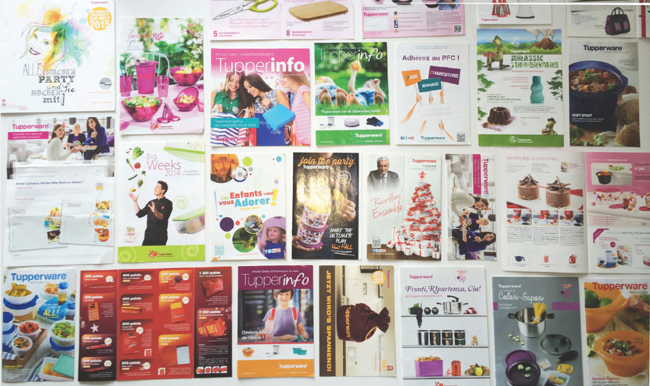 a flat overlay shot of old catalogs from different issues before the recent rebranding
