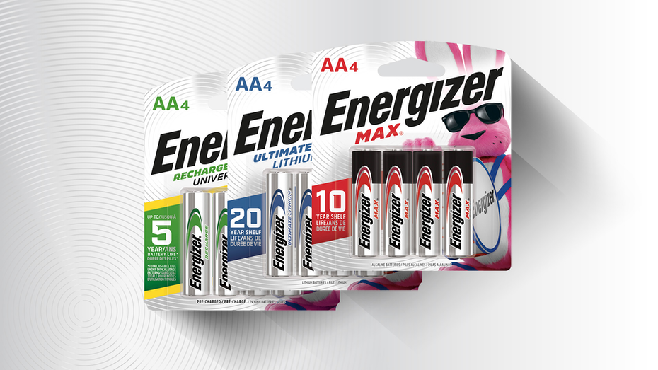 three packages of Energizer batteries with green, blue and red elements